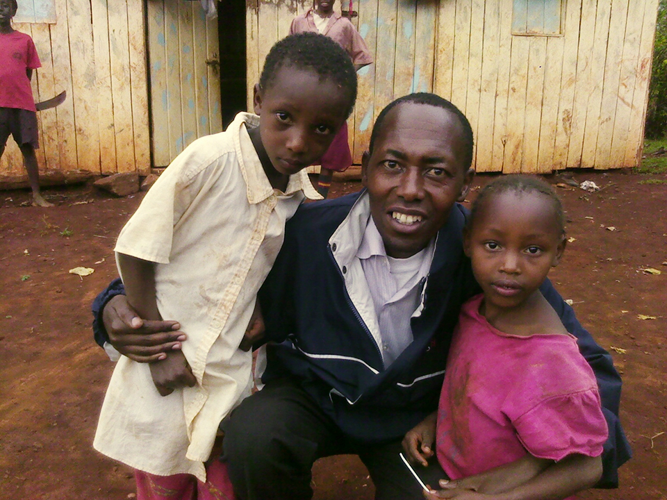 John-Wambugu,-his-sister-with-a-John-TKW